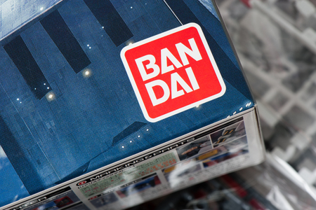 panoply: BANGKOK, THAILAND - MAY 16, 2015: Closeup logo of Bandai on Gundams box. Bandai Company, Limited is a Japanese toy making and video game company.