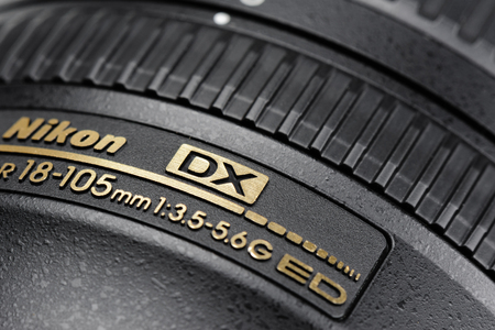 f 18: BANGKOK, THAILAND - MAY 14, 2015: CLoseup details of Nikon 18-105mm f3.5-5.6G AF-S lens. This lens was announced in August 2008 by Nikon Editorial