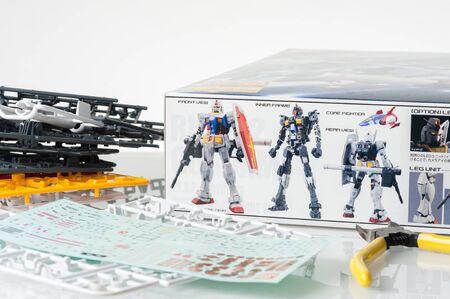 panoply: BANGKOK, THAILAND - MAY 17, 2015: Gundam on the box of master grade ver.3.0 RX-78-2 Gundam Model. Gundam models are model kits depicting the vehicles and characters of the fictional Gundam universe by Bandai. Editorial