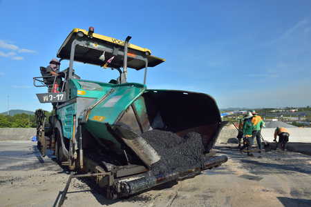 blacktop: CHONBURI, THAILAND - MAY 21, 2015 : The asphalt paver machine at road construction site. Editorial