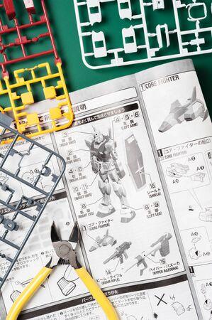 panoply: BANGKOK, THAILAND - MAY 17, 2015: Unassembled parts and manual of master grade ver.3.0 RX-78-2 Gundam Model. Gundam models are model kits depicting the vehicles and characters of the fictional Gundam universe by Bandai.