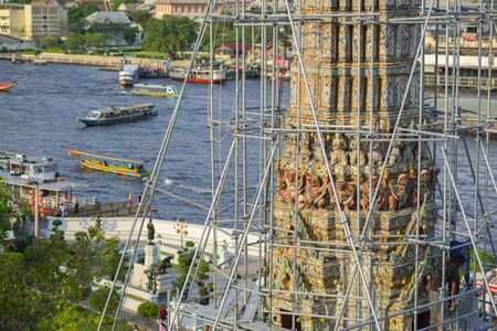 wat arun: BANGKOK, THAILAND - FEBRUARY 19, 2015: Closeup details on top of pagoda at Wat Arun during restoration in Bangkok, Thailand.