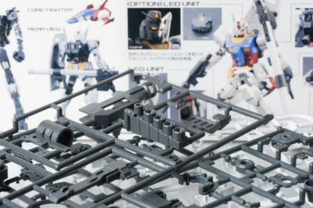 panoply: BANGKOK, THAILAND - MAY 17, 2015: Unassembled parts of master grade ver.3.0 RX-78-2 Gundam Model. Gundam models are model kits depicting the vehicles and characters of the fictional Gundam universe by Bandai.