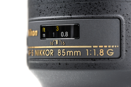 afs: BANGKOK, THAILAND - MAY 13, 2015: The Nikon 85mm f1.8G AF-S lens. This lens was announced in January 2012 by Nikon. Editorial