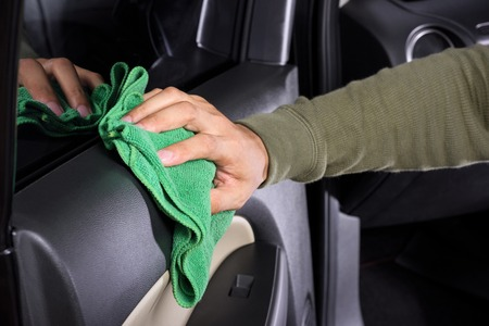 microfiber cloth: cleaning the car console with microfiber cloth