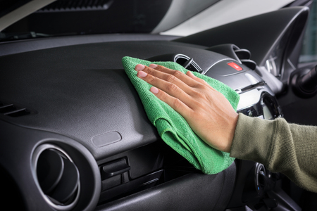 cleaning the car console with microfiber cloth