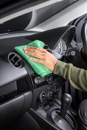 microfiber: cleaning the car console with microfiber cloth
