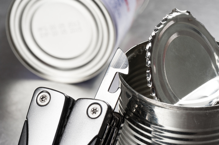 can opener: opening the tin with tin opener (can opener)