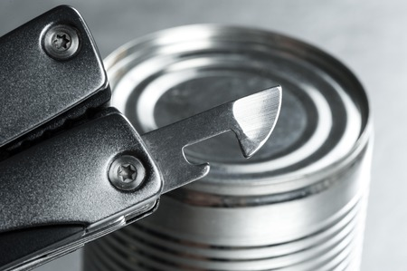 tin: opening the tin with tin opener (can opener)