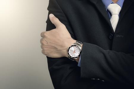 shiny suit: closeup luxury watch on businessmans wrist