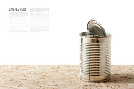 food can: closeup opened tin on wooden desk