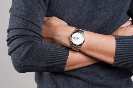 watch: closeup luxury watch on wrist of man