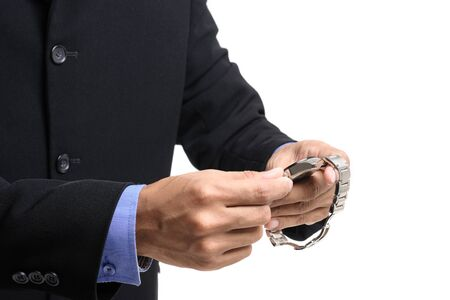 businessman adjusting the time on his watch
