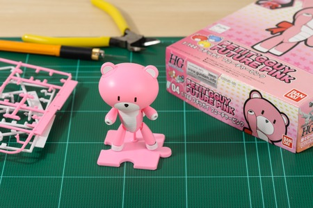 panoply: CHONBURI, THAILAND - AUGUST 10, 2015: Assembled Petitgguy model kits on cutting mat.