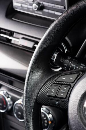 bottons: audio control bottons on steering wheel of modern car