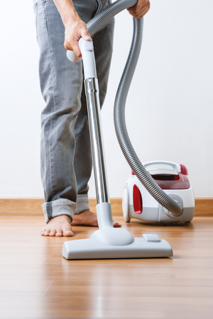housemaid: cleaning home with vacuum cleaner