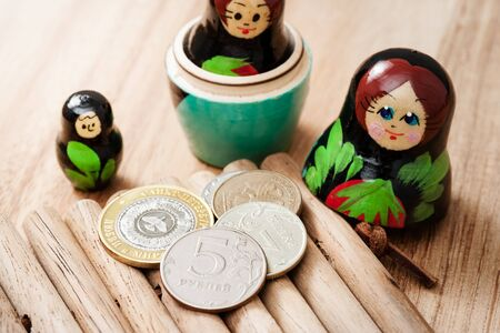 nesting: Russian coins and russian nesting doll Stock Photo