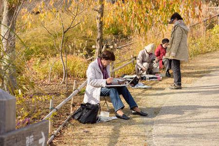 saiko: YAMANASHI, JAPAN - NOVEMBER 04, 2014: Unidentified japanese artist painting in Saiko Iyashi no Sato NENBA. Saiko Iyashi no Sato NENBA is a restored traditional village located in Fuji Kawaguchiko Town.
