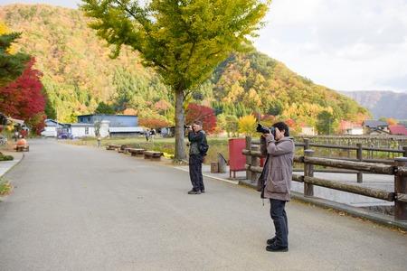 saiko: YAMANASHI, JAPAN - NOVEMBER 04, 2014: Unidentified japanese tourism photographing the view in Saiko Iyashi no Sato NENBA. Saiko Iyashi no Sato NENBA is a restored traditional village located in Fuji Kawaguchiko Town.
