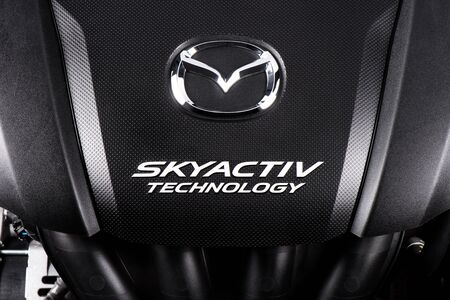 mazda: BANGKOK, THAILAND - SEPTEMBER 20, 2015: Engine of All New Mazda 2 with SKYACTIV Technology. SKYACTIV is a brand name for a series of technologies developed by Mazda which increase fuel efficiency and engine output.