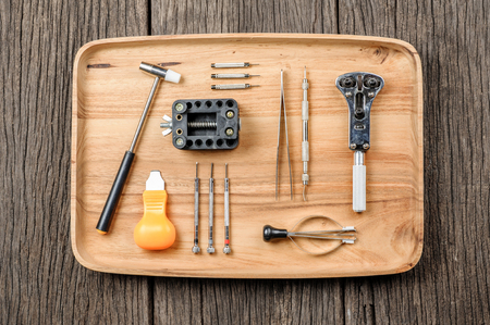 watchmaker: special tools for watchmaker on wooden tray Stock Photo