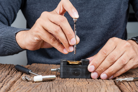 calibre: The man repairing the old watch Stock Photo