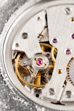 watch movement: closeup low quality movement of automatic watch
