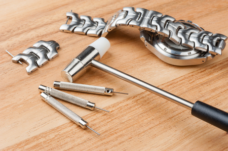 adjusting: adjusting the watch bracelet with pin punch