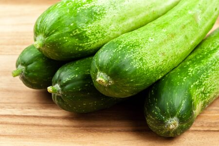 cucumbers: fresh cucumbers on wooden table
