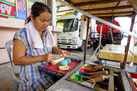 chonburi: CHONBURI, THAILAND - OCTOBER 15, 2015: Unidentified street candy maker in Chonburi, Thailand.