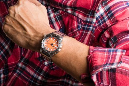 mans watch: closeup luxury watch on mans wrist