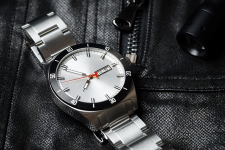 calibre: closeup 3 hands luxury mens watch