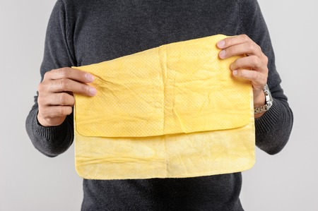 pva: yellow PVA chamois for car cleaning in mans hand Stock Photo
