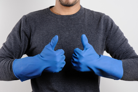 work gloves: The mans hands in blue rubber gloves ready to cleaning.