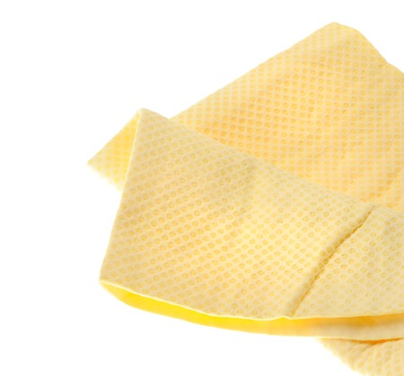 pva: yellow PVA chamois for car cleaning isolated on white background