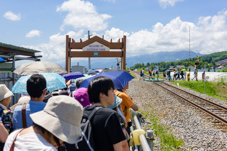 spacial: HOKKAIDO, JAPAN - JULY 24, 2015: Lavender Farm Station in Naka Furano, Hokkaido, Japan. The station opens only on selected dates in year and only selected trains stop at the station.