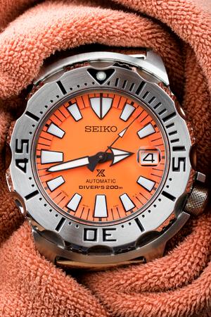 calibre: BANGKOK, THAILAND - NOVEMBER 04, 2015: The SEIKO Prospex 200M Diver Automatic SBDC023 Orange dial.