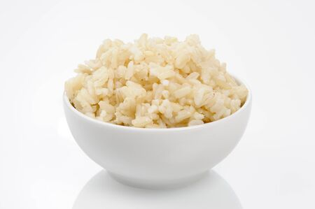 cooked brown rice in white bowl