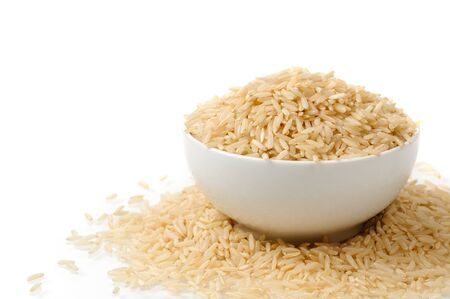 brown rice in white bowl Stock Photo