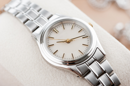 classic woman: closeup classic woman wristwatch with stainless steel bracelet