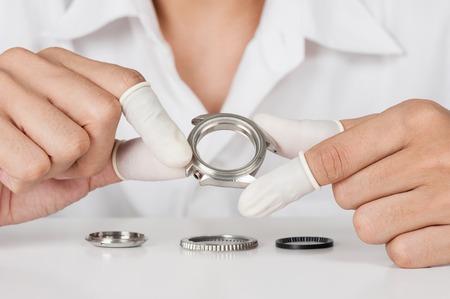 watchmaker: watchmaker repairing the wristwatch