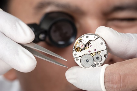watchmaker: watchmaker repairing the automatic wristwatch