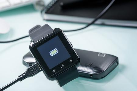 charging battery of black smart watch 写真素材