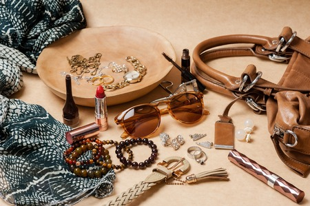 pendent: woman accessories on brown background