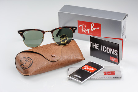 ray ban: BANGKOK, THAILAND - DECEMBER 16, 2015: The Ray-Ban Club Master RB3016 W0366 -Tortoise and accessories. Ray-Ban is a brand of sunglasses and eyeglasses founded in 1937 by Bausch & Lomb.
