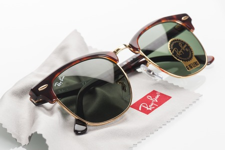ray ban: BANGKOK, THAILAND - DECEMBER 17, 2015: The Ray-Ban Club Master RB3016 W0366 -Tortoise. Ray-Ban is a brand of sunglasses and eyeglasses founded in 1937 by American company Bausch & Lomb. Editorial