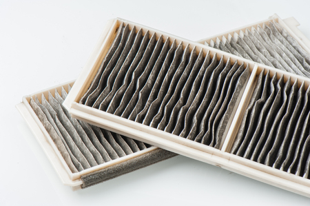 worn cabin air conditioner filter of car Stock Photo