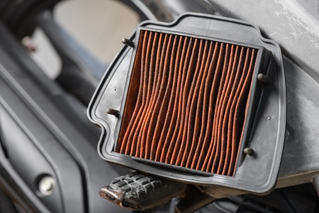 closeup worn motorcycle air filter