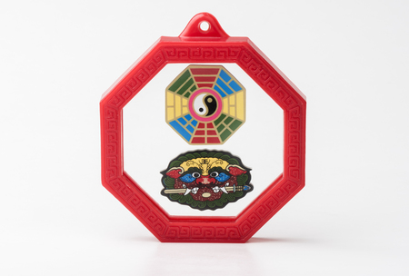 energy use: Octagon mirror or Feng Shui Bagua Mirror, Chinese use to repel negative energy. Stock Photo