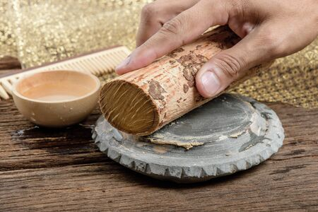 thanaka: Thanaka wood and Kyauk pyin stone slab